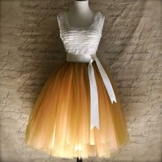 Women's tulle skirt in antique gold over peach lined in ivory satin with satin sash waist. Over 50 Womens Fashion, Fashion Tips For Women, Fashion Over 50, Fashion Ideas, Fashion Hacks, Fashion Trends, Flower Girl Tutu, Flower Girl Dresses, Tutu Women