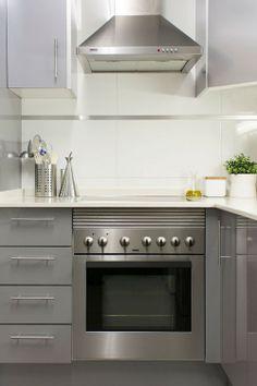 Design Sponge: This kitchen has an industrial/metallic white look.