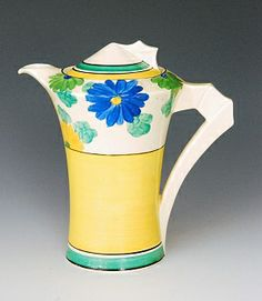 A Clarice Cliff Sungay pattern Daffodil shape coffee pot and cover circa 1932/33 hand painted with stylised flowers and foliage with green, black and yellow banding, printed SUNGAY and Bizarre mark, height 18cm,