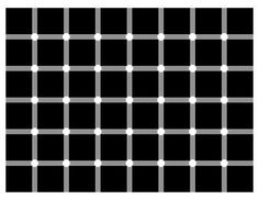 Thats weird. The ones you are looking at look white and all the others look black. As soon as you look at another dot it changes. Try it out.