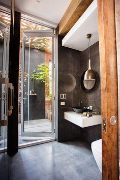 Cool bathroom.  Concrete tiles, timber sliding door, pendant lamp.