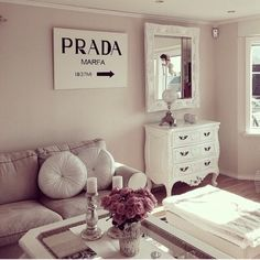 Prada sign from Lily's penthouse in gossip girl amongst white and neutrals <3