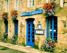 <3 the colorful door and windows, brick facade and flowers! Pancake restaurant facade. Tréguier. Côtes-d'Armor , Brittany, France.
