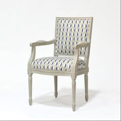 LOVE this elegant but not too serious chair (and the gray-washed wood).