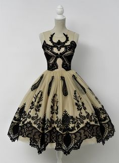 """<p class=""""p1""""><span class=""""s1"""">From a teacup of ink-black embroidery make a frosting for the caramel tulle. Add as many ruffles as you like and serve on the happiest nights.Any resemblance to deer antlers is pure coincidence!</span></p>"""