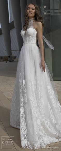 NOYA By Riki Dalal Wedding Dresses Spring 2019 : Forever Bridal Collection - CHARLOTTE. Sleeveless lace halter neck ball gown wedding dress. Backless princess ballgown chapel train and bow. #weddingdress #weddingdresses #bridalgown #bridal #bridalgowns #weddinggown #bridetobe #weddings #bride #weddinginspiration #weddingideas #bridalcollection #bridaldress #fashion #dress See more gorgeous bridal gowns by clicking on the photo
