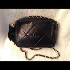 """Authentic Chanel Diamond Quilt Tassel Camera Bag In nice condition. Deep navy blue lambskin with top zip and inside pocket. 7 x 5 x 2 1/4 with 18"""" drop from chain. The chain has some fading, but still very pretty. Some slight wear on corners, but no holes or broken piping. Authentic with black dustbag. Serial number present and complete on sticker; begins with 05.  Serious offers welcome. Absolutely no trades. CHANEL Bags Shoulder Bags"""