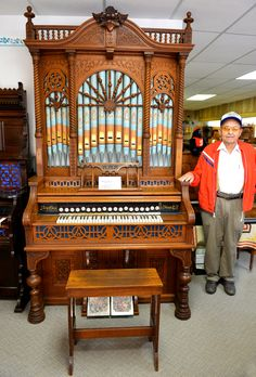 Dick Rhea with his prized pump organ at Rhea's Antique Pump Organs in Sharon Springs, Kansas.