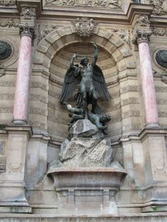 Paris, France - (Latin Quarters) Saint Michel, The statue of Saint Michael atop the fountain in the Place Saint-Michel at the northern end of the Boulevard Saint-Michel 1856
