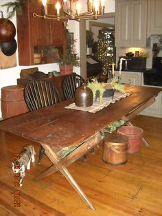 Sawbuck table in my kitchen.This is a wonderful table!   we could make this with all the wood from the old barns