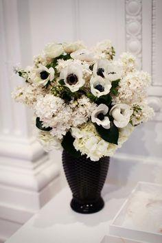 black vase, ivory flowers, with pops of purple
