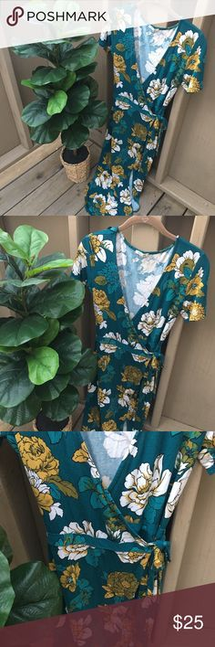 🌵🌻👗Pretty Wrap-Around Summer Dress👗🌻🌵 🌵🌻👗Pretty Wrap-Around Summer Dress👗🌻🌵 This fun, floral dress can be dressed up or down! It's perfect for any weekday lunch, or weekend fun! Pair with a jean jacket and cute wedges to complete your look! Has a beautiful green and yellow floral print and a wrap around tie for closure. Super comfortable! Great condition! Comes from a smoke-free, pet-free home:)💕 Bleuh Ciel Dresses Maxi