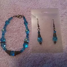 """?? Aqua & Bronze NWT Earrings & Bracelet Brad New, Earrings on Card & Bracelet never used set in in Aqua Blue & Bronze. Earrings are drop.  Bracelet measures 8"""" with hardware.  Handmade from a local boutique in Historic LeClaire, IA - LeClaire is home of the American Pickers! Boutique Jewelry"""