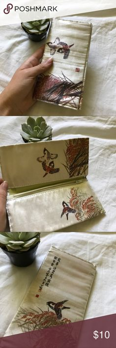 Vintage Japanese Cloth/Silk Wallet Vintage Japanese wallet | similar to the other wallet I had listed, however this one does have one small hole in the inside lining that will lower price | two compartments with one zipper compartment | Beautiful statement piece for your vintage look 🌿| • Will be packaged and shipped within one day from CA • | Vintage Bags Wallets