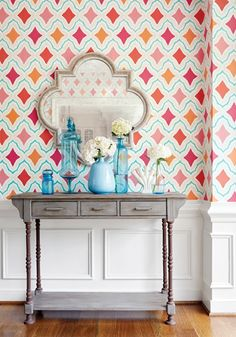 Cruising Wallpaper A fresh and punchy wallpaper with an ikat-inspired trellis design enclosing diamond motifs in lush oranges and pinks.