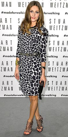 """OLIVIA PALERMO If you've never agreed with the phrase, """"Animal prints are totally a neutral,"""" this dress is here to finally change your mind. Olivia wears the black-and-white giraffe-print Whistles dress with bold accessories: strappy Stuart Weitzman heels, double cuffs, a silver belt and a collar necklace."""