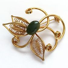 Gold plated filigree pin brooch with genuine oval jade cabochon. Jade ... Lot 79