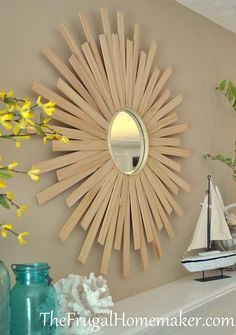 DIY Sunburst Mirror:This mirror is made using the paint sticks or cedar shims,a mirror and an embroidery ring.This looks easy.