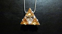 Triforce made of sterling silver and zircons.
