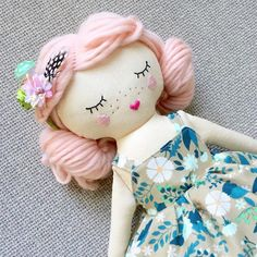 Only 2 dolls left in my shop. Including this little lady (which is actually my favorite of the bunch). There are also a couple guitars. 😊
