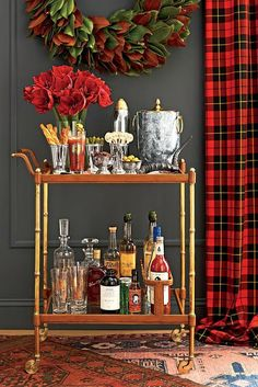 Southern Living A bamboo Chinoiserie bar cart and tartan curtains are a great combination. Diy Bar Cart, Bar Cart Decor, Bar Cart Styling, Bar Carts, Bar Trolley, Drinks Trolley, Brass Bar Cart, Gold Bar Cart, Drink Cart
