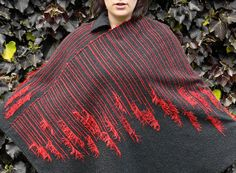 how did she do that?  Handwoven Poncho in Graphite Grey with Red Accents. £200.00, via Etsy.