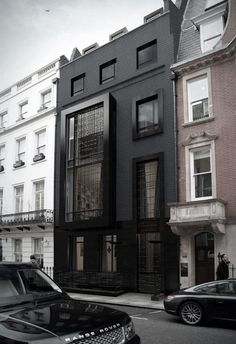 bold in black // #architecture #modern Love this! Great conversation between the old and modern.