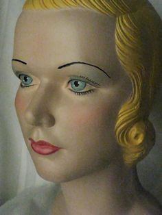 Special order: black hair, dark sapphire blue eyes, red lips, same blush, no blue eyeshadow, but natural looking brown contouring eyeshadow instead... and black cat-eye liquid eyeliner, if possible. Vintage Style Mannequin Head. $175.00, via Etsy.