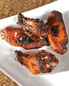 "This great recipe for spicy-sweet chicken wings is courtesy of Suvir Saran and can be found in ""American Masala."""