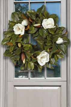 Our realistic looking Magnolia Wreath is a perfect way to decorate for the holiday season - or anytime! It has a loop on the back for easy hanging.
