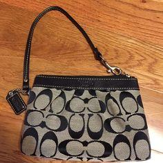 Coach black & grey wristlet Black & grey coach wristlet with zipper Coach Bags Clutches & Wristlets