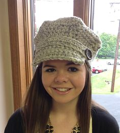 This unique brimmed cap is a great twist on the brim hats of the past.  Very cute & perky,  just right for any outdoor activity!  The brim has a band directly above which can be removed.  It is attached by two decorative buttons which stay attached to the hat.  And the light grey goes great with most jackets or coat colors!This crocheted cap is sized for a small to medium adult and is ready for immediate shipment.  This cute hat can be made in any number of colors.  Please give one week…