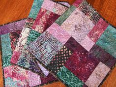 This beautiful quilted batik table runner was made with a collection called Hummingbird from Timeless Treasures. It includes gorgeous shades of purple