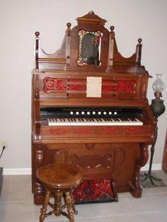 1893 Taylor & Farley pump organ, Oak in Color includes claw foot stool.