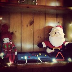 Elf on the shelf- playing pool with Santa