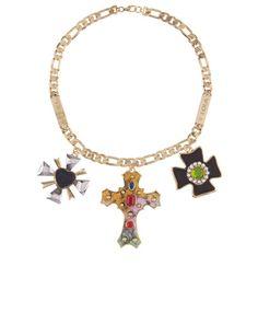 Collar con cadena y cruces de metal en diferentes acabados con aplicaciones en piel, resina y purpurina de Bimba (115 euros). http://www.marie-claire.es/moda/accesorios/fotos/collares-grandes-moda-verano/bimba-lola-5
