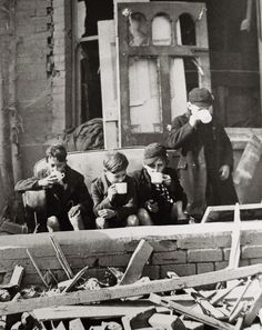 Children drink up in the ruins of London. The Blitz, WWII.