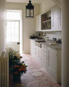 2 Flower room credit Plain English small Once upon a time, houses had a wealth of rooms dedicated to particular activities – rooms that rarely appear in our modern homes. We look at how to integrate these useful spaces back into our… Shaker Kitchen, New Kitchen, Kitchen Decor, Country Kitchen, Narrow Kitchen, Plain English Kitchen, English Kitchens, Cocinas Kitchen, Flower Room