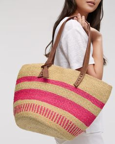 In collaboration with The Basket Room, this handwoven shopper has been made by a small female craft collective in Kenya. Traditionally called a Kiondo and crafted in rural communities, this modern design is made from sisal grass and finished with leather straps. Each is unique with no two pieces exactly the same and is ideal for shopping, taking to the beach or simply as a style statement.