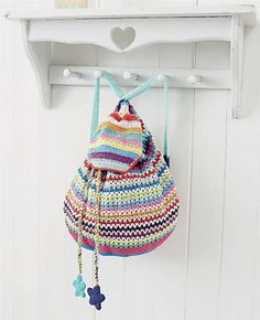 Crochet backpack pattern. The pattern also contains the pattern of the stars that are attached to the bag.