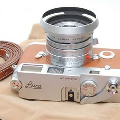These old Leica cameras are the bomb! They are not cheap (never were) but they do sport the famous Carl Zeis lenses.