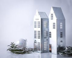A set of two candle holders tin houses Amsterdam and Stockholm. Zinc candle holders with industrial styling. little houses