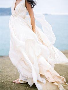 Gorgeous flowing gown: http://www.stylemepretty.com/california-weddings/2015/03/16/romantic-coastal-wedding-inspiration/ | Photography: Coco Tran - www.cocotran.com