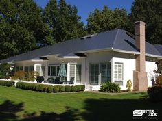 Charcoal Grey Interlock Shingle roof from SW French Prairie Drive, Wilsonville, OR 97070. Installed by Interlock Industries, Inc. www.oregonsbestroof.com 1-800-284-8680