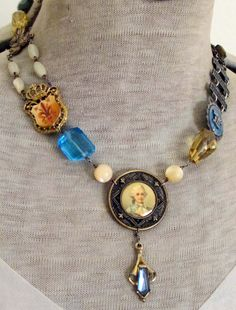 french general - vintage assemblage necklace with lithograph button, gemstones and fleur de lis crown finding by the french circus. $185.00, via Etsy.