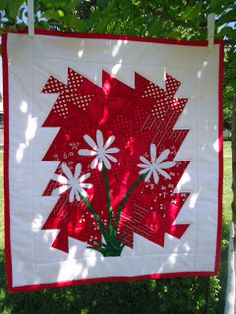 flowers make a cute addition to this little twister quilt by:  Why Knot?: Twirled Into A Twister & More