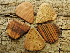 SALE: Buy 4 Get the 5th one FREE - Wooden Guitar Picks - (Choose Wood Types)   Check it out at my shop on Etsy.com: (CLICK THE LINK BELOW) https://www.etsy.com/listing/160238799/sale-buy-4-get-the-5th-one-free-wooden?ref=shop_home_active