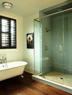 really love the color of the tile in the shower and the claw foot tub of course. Wood floors are nice too.