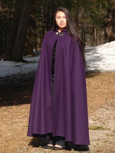 Our half-circle wool cloak with hood provides protection from wind, rain and cold. Ending at ankle to mid-calf on most, the half-circle cloak closes at the collar with a leather loop and single metal