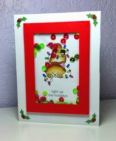 Corilyn's Creations: Lighting up the holidays Shaker card with Christmas kitty and lights using stamps by Newton's Nook Designs